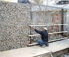 concrete and cinder block debris filled fence