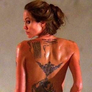 Angelina Jolie Tattoos  Angelina Jolie's tattoos chronicle how the actress rose from the young girl who appeared in music videos to an Academy Award-winning leading lady and acclaimed humanitarian. Though some of her tattoos have been removed, the faint outlines remain as a reminder of where she's been and how far she's come throughout the years.  Some of the earliest Angelina Jolie tattoos were done when she was just starting out in the entertainment business and appearing in films like…