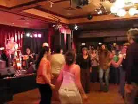 """Running the Goat, Figgy Duff on stage -  YouTube - A group of dancers performs """"Running the Goat"""" while Figgy Duff plays on stage. This was at the release party for Figgy Duff's CD recorded at their 25th reunion."""