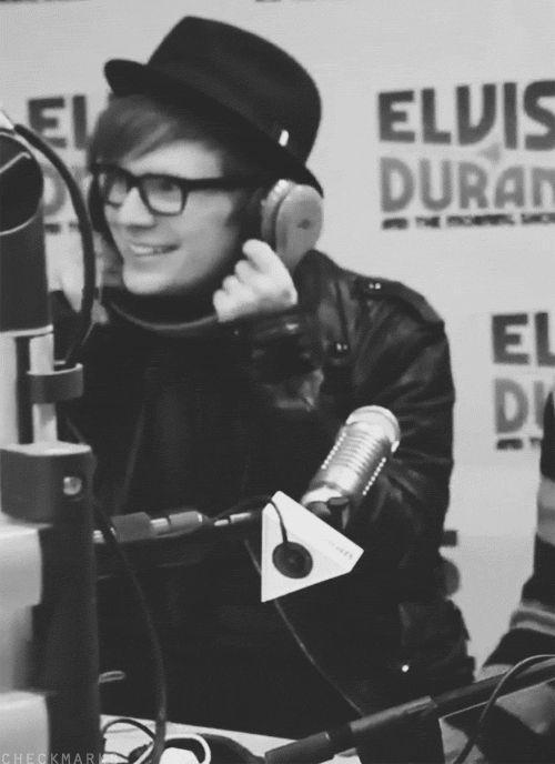 He is AdoRABle. I love how he doesn't take his hat off and just holds the headphones like that :3