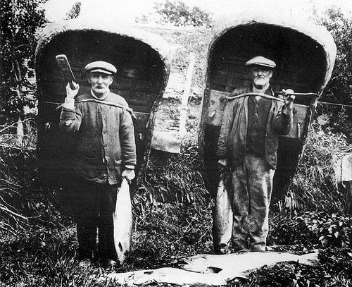 Coracle men with their catch of fish 1905 by MuseumWales, via Flickr. Coracle men still fish today in Carmarthenshire (2013)