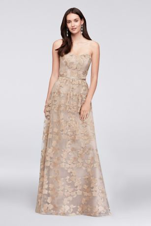 This elegant bridesmaid dress from Oleg Cassini includes some of the high-fashion hallmarks of the designer's wedding dresses. Metallic botanical embroidery a sleek satin waistband lend the sweetheart gown lovely detail.  Oleg Cassini, exclusively at David's Bridal  Polyester  Back zipper; fully lined  Dry clean  Imported