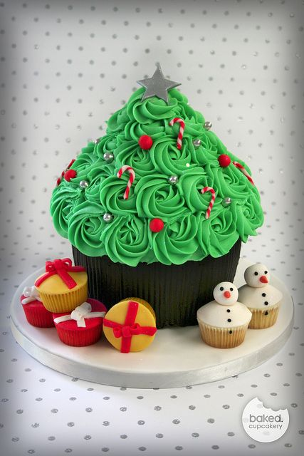 Giant Cupcake Christmas Tree    i am certain, I could bake the cake, however I would most likely fail miserably at the decor :-(