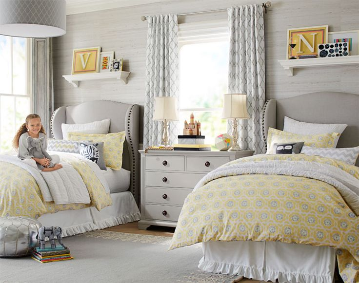 This yellow and gray bedroom for two girls is charming, contemporary and just a little bit luxe