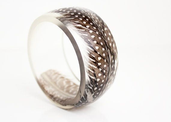round resin bangle featuring guinea fowl feather от RosellaResin
