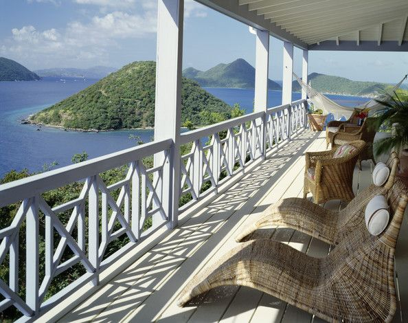 Tropical Porch Photo with Wicker Seating