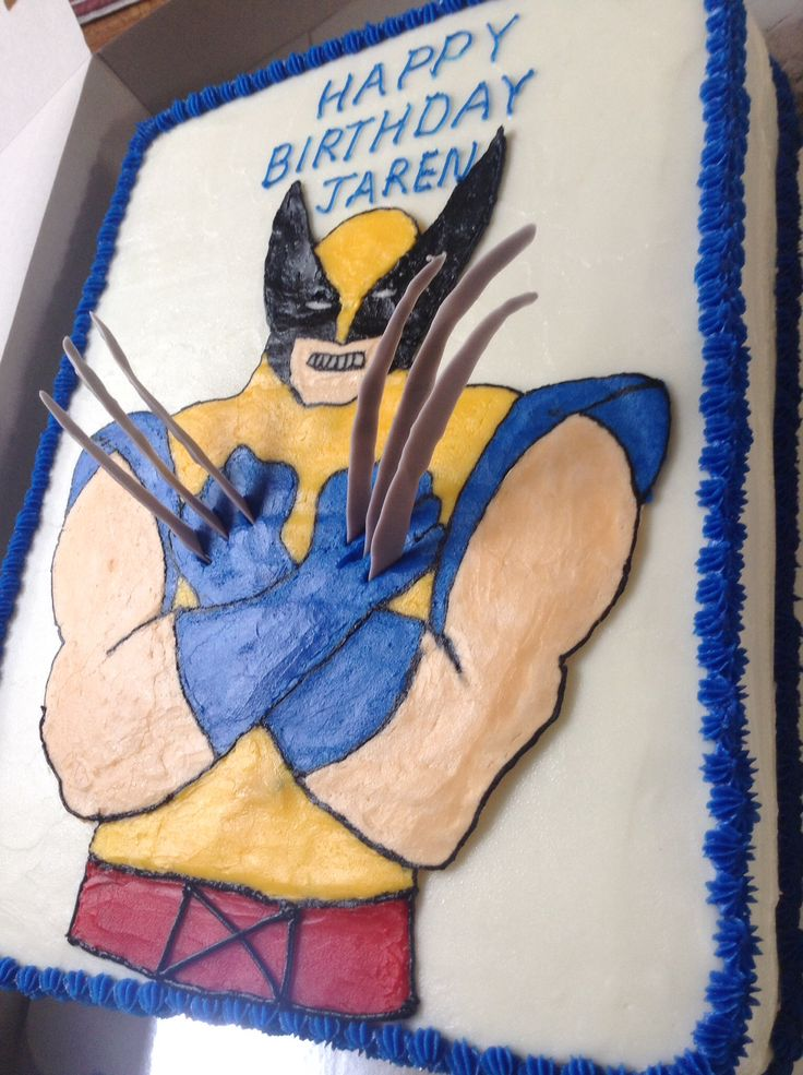 X-men wolverine birthday cake with talons made of chocolate.