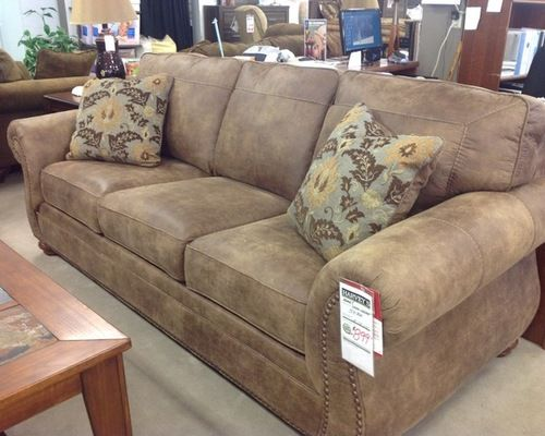 Harvey's Showroom Furniture Sofas & Chairs - Brown distressed look faux leather sofa with nail head