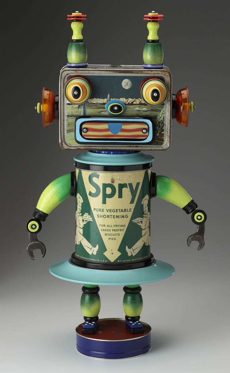 Robot sculpture made from re-purposed materials- space lunch box, vintage tin, wrenches, painted wooden pieces. Created by Mark Brown, 2011,...