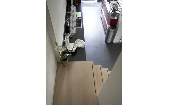 Interior view on open kitchen and stairs