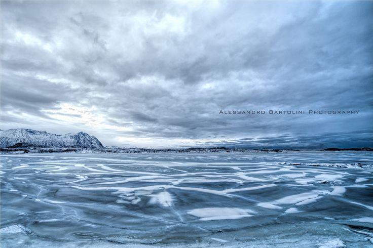 Cracked frozen lake by Alessandro Bartolini on 500px