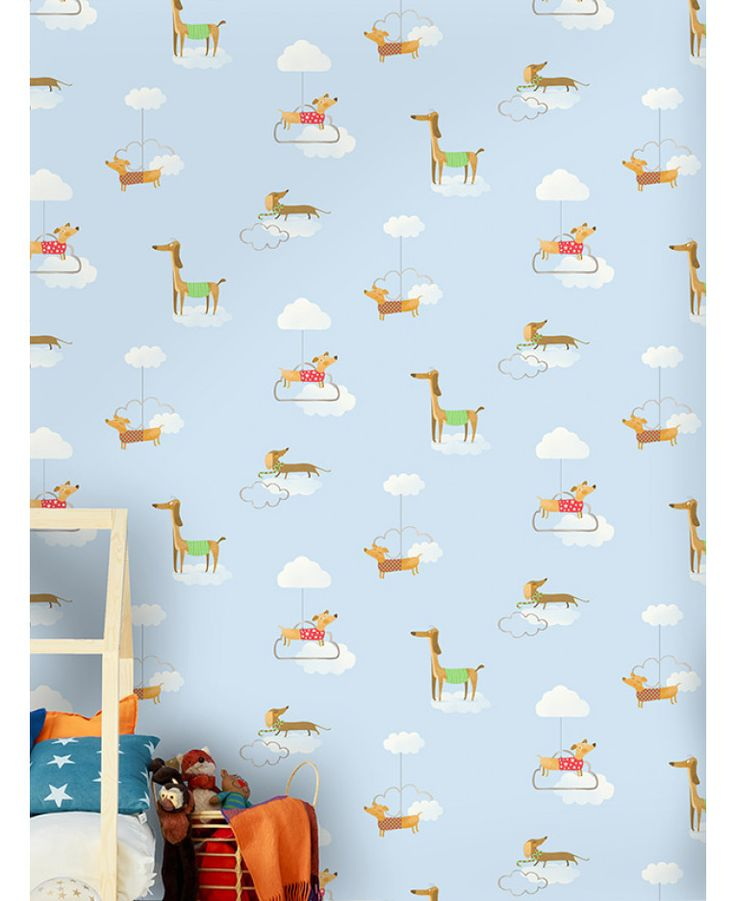 This Walkies Sausage Dog Wallpaper features adorable dachshunds in jumpers and scarves set amongst white clouds on a pale blue background. Free UK delivery available