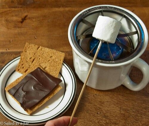 Smores on a table top grill made from a soup mug and apple slicer.