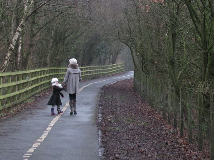 Scenic - This is a beautiful photo and I love the way that the little girl is looking back at the camera whilst the woman is still walking down the path. I love the path too, the way it turns so you can see far on into the distance which gives this photo depth. This is a great winter/spring scene and a great contribution to the spring album.