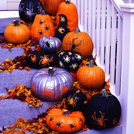 Easy Halloween Decorations - spray paint and spider cutouts/stickers!  These would be cute along the front walkway. I bet the kids could even do these!