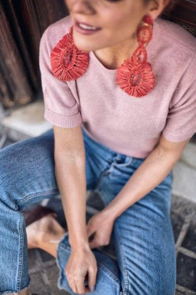 Oversized earrings with a simple shirt and jeans