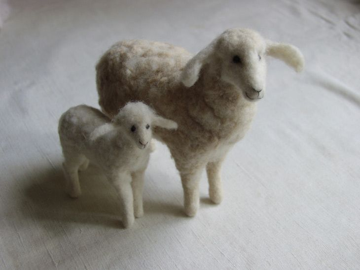 I LOVE these! I have something similar from the Renaissance Fair that they made into pins. I wear a few at a time. It's like having a miniature herd of sheep on your shoulder :) needle-felted sheep and lamb