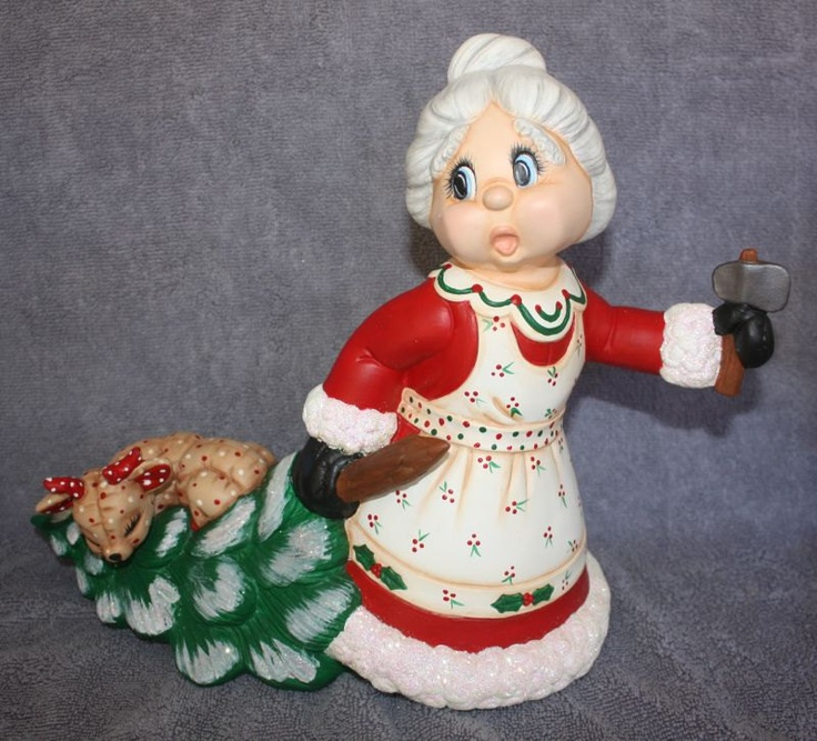 Handpainted Ceramic Mrs. Claus pulling a tree with a baby softy deer in one hand and an axe in the other. $55.95, via Etsy.