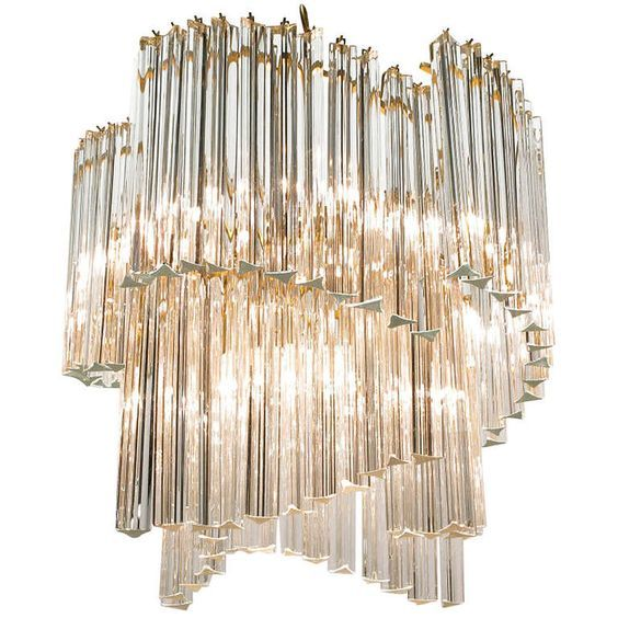 A chandelier just like the one over the dining room table inside The Beverly Hilton's Suite 100. #bhsuite #lamps #crystal See more at http://memoir.pt/