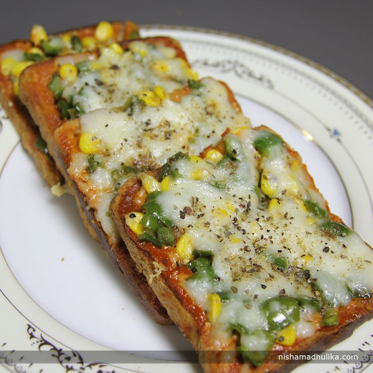 Bread pizza gives you the divine flavor of cheesy pizza made with bread slices. Recipe in English- http://indiangoodfood.com/2017-bread-pizza-recipe.html (copy and paste link into browser)