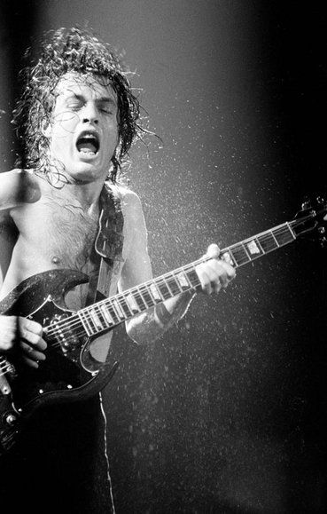 Angus Young: Lead guiterist of AC/DC. Australia.