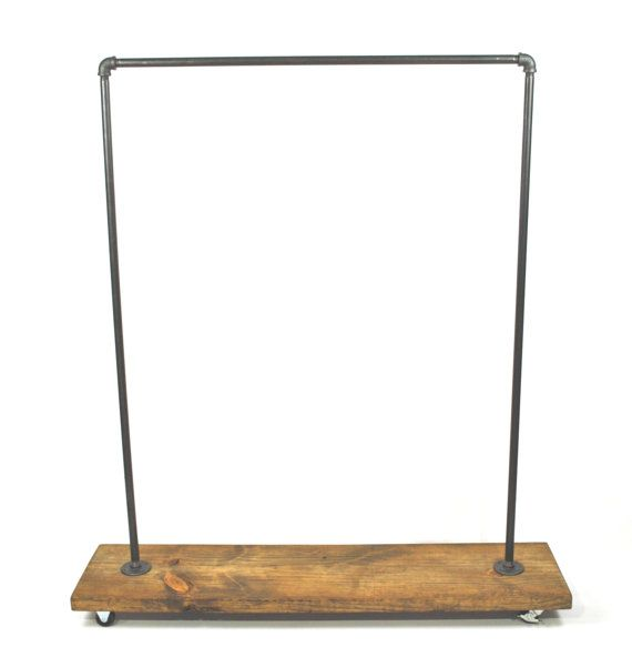This garment rack is built from iron piping and mildly distressed wood. it will add a touch of class to a loft, office, rustic style home