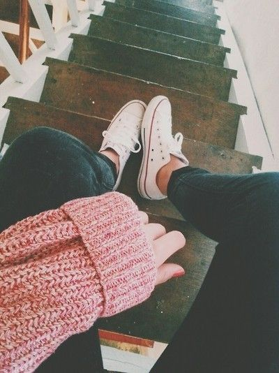 peach sweater, gray jeans, white sneakers