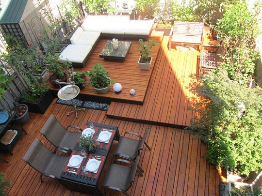 This large and clever deck, spotted in New York Magazine, uses freestanding wooden platforms at different levels to create seating and eating areas. The platforms are raised for drainage and can be removed for maintenance.