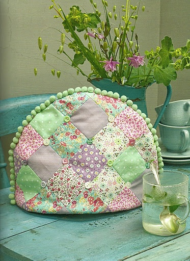 . pretty colors..nice tea cozy..would leave off the balls though..