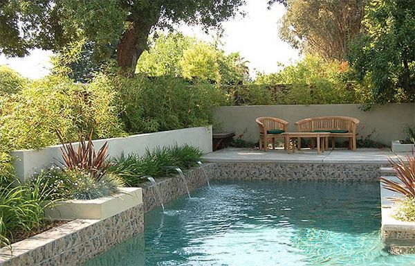 Grand enjoyment without grand scale — that's this garden and pool spot in a small residential yard, a design by Huettl Landscape Architecture.