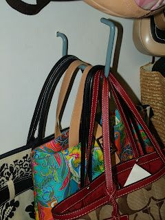 Use bike hooks...found at the hardware store...to hang purses.  Neat, orderly, and clears up valuable closet space