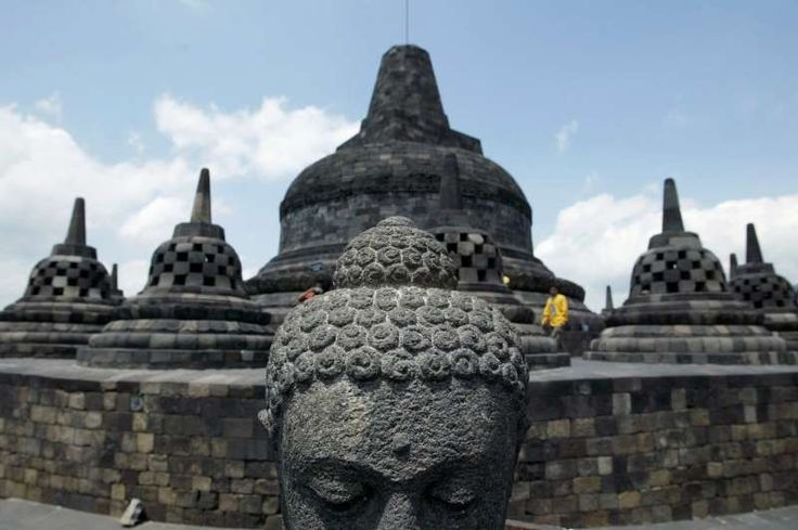 Borobudur Temple ﴾Magelang, Indonesia﴿ Another UNESCO World Heritage Site, the Buddhist temple date from the 8th and 9th centuries—it is 300 years older than Angkor Wat in Cambodia. More than 500 Buddha statues are perched around the temple.