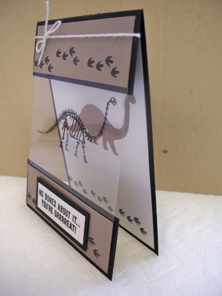 handmade card ... No Bones About It by D. Daisy ... acetate panel with stamped bones lines up with solid dinosaur image on the inside ... Stampin' Up!