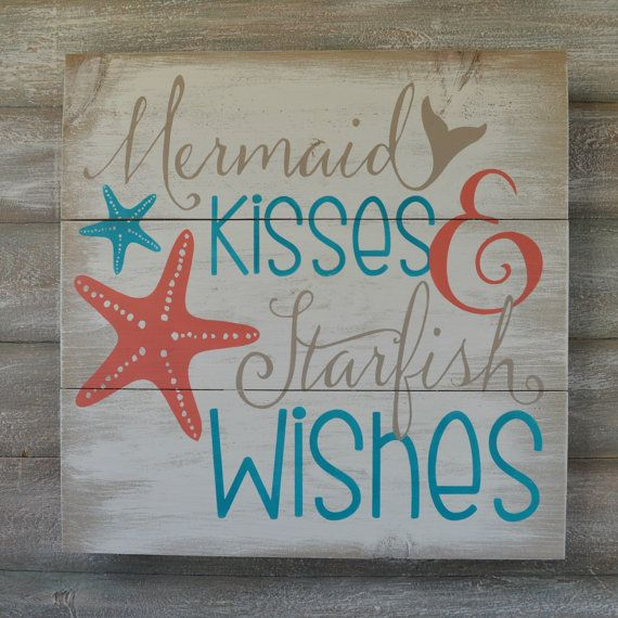 This wood sign features the words Mermaid Kisses and Starfish wishes painted in deep coral, turquoise and light tan all on a off white background that has been heavily distressed. It would make a great compliment to your beach or mermaid decor and would also make a nice gift.  This sign measures approximately 16 x 16. A wire hanger is attached to the back for easy hanging.  I can also create this design in different sizes or colors. Please feel free to contact me with any questions that you…