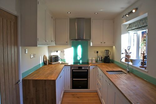 Framed Shaker Style kitchen, hand finished with solid Oak worktops and glass upstands and splash back