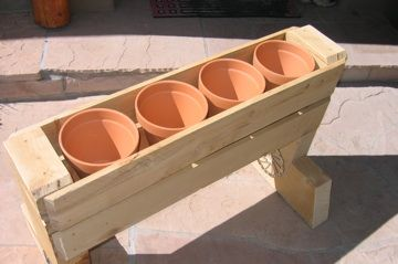 Here's an example of using scrap wood to make a planter box. The clay pots were about $4 each. They will work well for herbs and flowers on front porch.