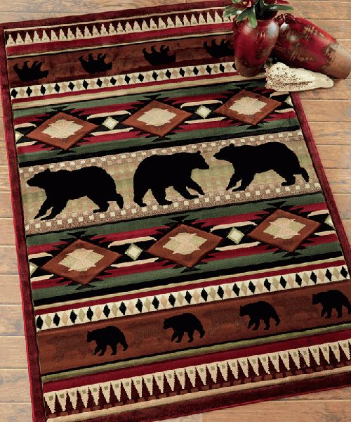 Native Bear Rug - Wildlife Rugs Native Bear Rug: Hand-carved bears and geometric designs in toffee, green, burgundy, beige and black give the heavyweight olefin Native Bear Toffee Rug Collection lodge beauty. These bear rugs feature a jute/poly backing. Stain and fade resistant.