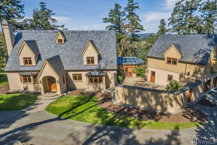 HOME ON ACREAGE - San Juan Island, WA.  Beautiful English Style 4857± sf, 4 bed/4.5 bath home on an elevated plateau in the middle of 38± acres of gorgeous land (two parcels in the central 5 acre portion surrounded by 33± acres in conservation). Close to Snug Harbor Resort & Marina. MLS#1149267$1,875,000. Coldwell Banker/San Juan Islands, Inc.  www.SamBuck.com