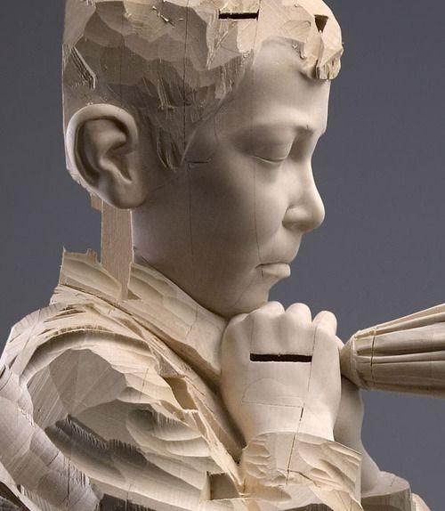 Wooden sculptures by Italian artist Gehard Demetz