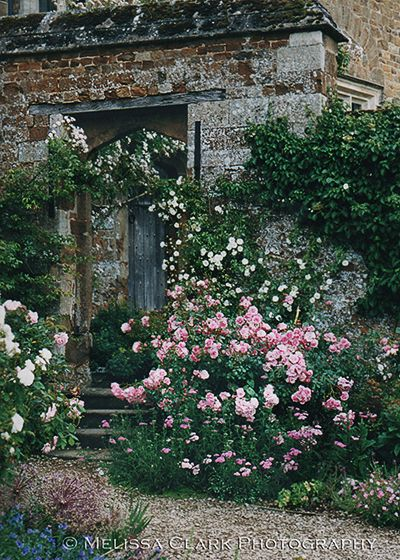 Roses next to the entry to a walled garden at Broughton Castle.