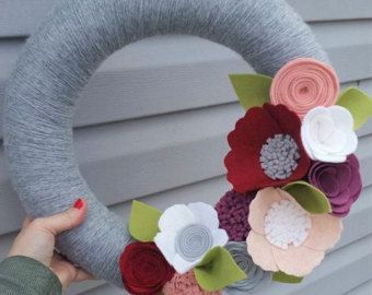 This wreath measures 14 inches around and is embellished with beautiful natural shades of pink, peach, white and coffee.  Some wreaths may measure a bit larger after decorative additions. All flowers are hand cut with care and made with a sturdy wool felt blend.  **Product comes from a smoke and pet free home**