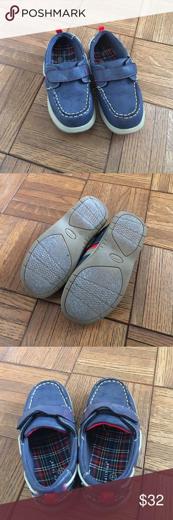 Like new boys blue boat shoe. Size US 11 Blue boys boat shoe with Velcro closure. Like new with very minimal signs of wear on bottom of soul. Boys US size 11 Shoes