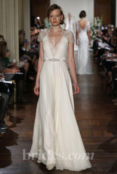 "Brides.com: Wedding Bloggers' Favorite Wedding Dresses from Fall 2013. ""I love that this dress pairs elegance and romance with a chic, modern style. The flowing fabric, plunging neckline and embellished shoulders are my favorite things ever!""  —Cyd Converse  Browse more Jenny Packham wedding dresses."