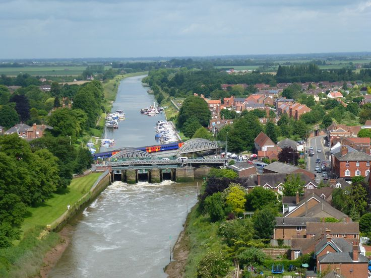 View of the Sluice Bridge over the River Witham that meanders through the town, from the first floor balcony
