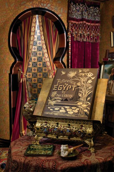 A bookstand is the sine qua non for a library, as with this elaborate, bejeweled and gilded metal stand ca. 1880, which displays an equally ornate volume on the mysteries of Egypt, and sits appropriately in an early-20th-century Turkish room. (Brian Coleman's Residence / Seattle, Photo: William Wright.