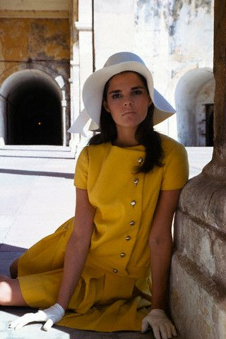 Ali MacGraw modeling a suit by Jacques Tiffeau, white felt hat by Emme, and white kid gloves. 1967.