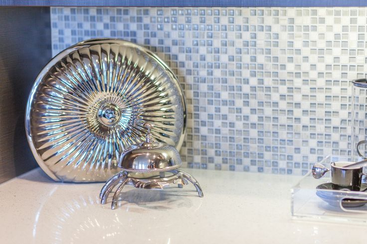 Kitchen gets a touch of beach inspiration with a crab bell and shell. Always add an element of fun in your design.