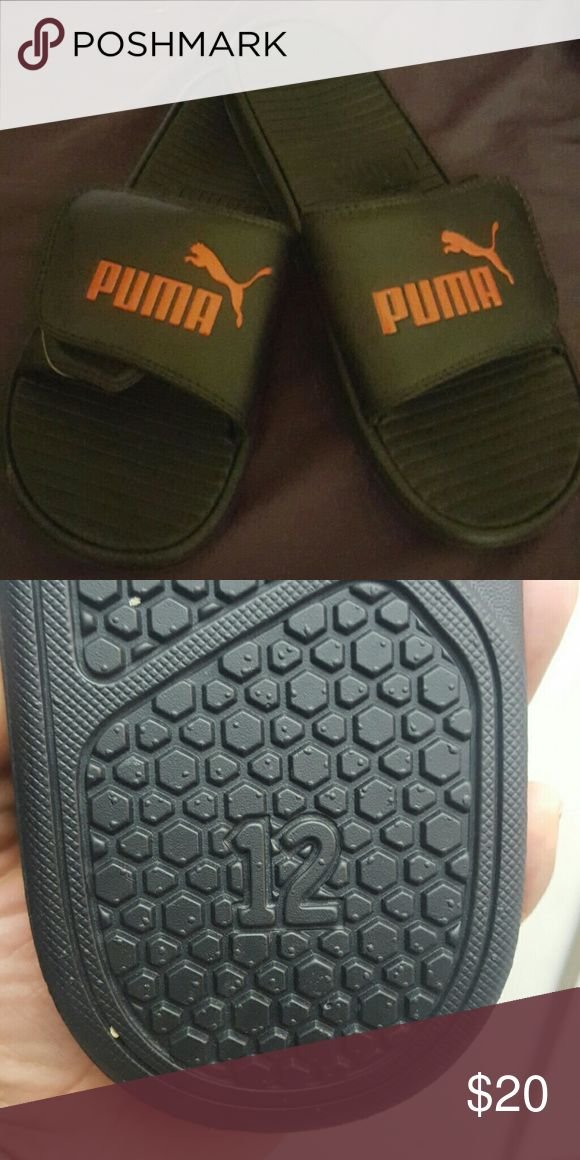 Mens Puma Sandals size 12 - New w/out tags New Black and Red Puma Sandals for men. Never worn. Puma Shoes Sandals & Flip-Flops