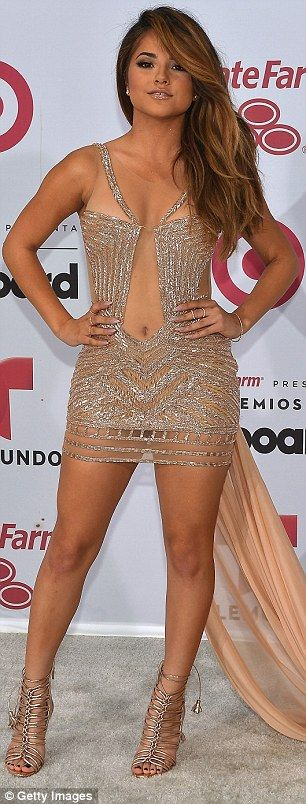 Also in attendance: Becky G showed off her midriff in a plunging mini dress...