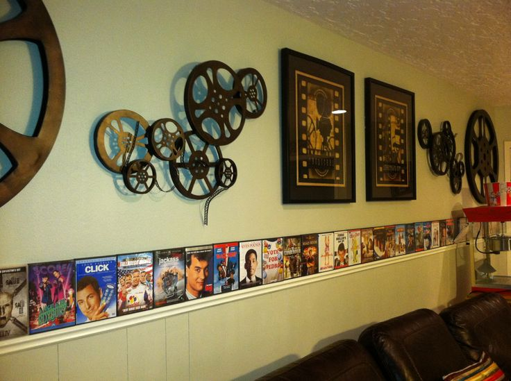 "Theater Room Ideas. Take empty DVD boxes and display along the wall for added ""free"" decor. This is actually our theater room."
